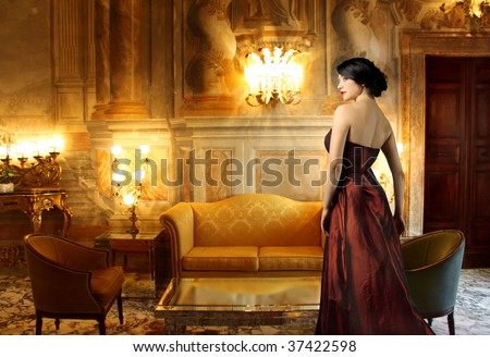 beautiful lady in a luxury living room - stock photo