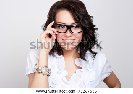 Beautiful lady in black glasses - stock photo