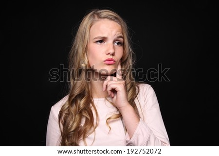 Beautiful lady in front of a black background - stock photo