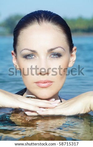 Beautiful lady in the water. Close-up headshot with natural colors - stock photo