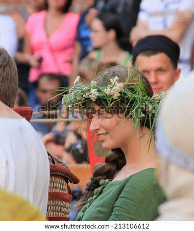 Beautiful lady of the young knight. Knightly tournament in old castle in Vyborg (Russia) 26 july 2014. - stock photo