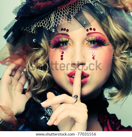Beautiful lady with artistic make-up.Doll style. - stock photo