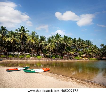 Beautiful lagoon with kayak boats at Cola beach resort in Goa, India - stock photo
