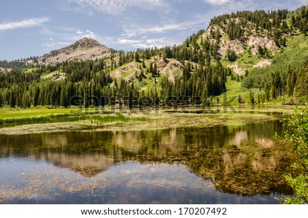 Beautiful lake and reflection in the Wasatch Mountains in Utah - stock photo