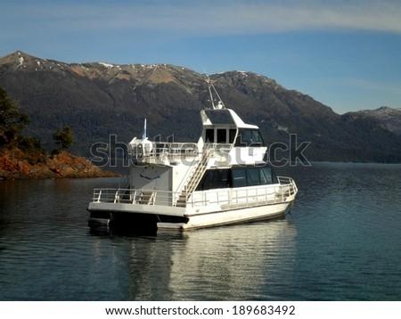 Beautiful lake boat mountains Patagonia Argentina. - stock photo