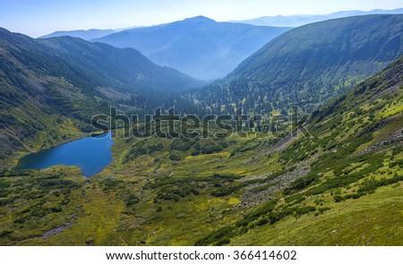 Beautiful lake in Siberia mountains - stock photo