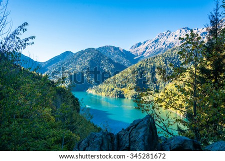 Beautiful lake Ritsa in the autumn afternoon, the Caucasus, Abkhazia.  - stock photo