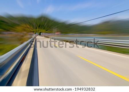 Beautiful lake road - stock photo