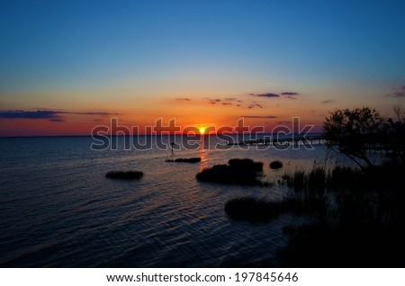 Beautiful lake sunset - stock photo