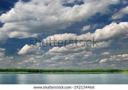 Beautiful lake with dramatic clouds. - stock photo