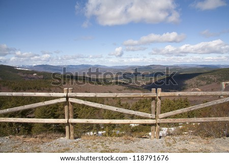 Beautiful landscape behind a wooden fence in the Natural Park Sierra Cebollera, La Rioja, Spain. - stock photo