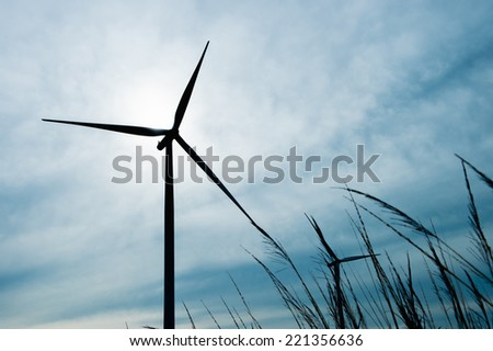 beautiful landscape image with Windturbine at the sunrise