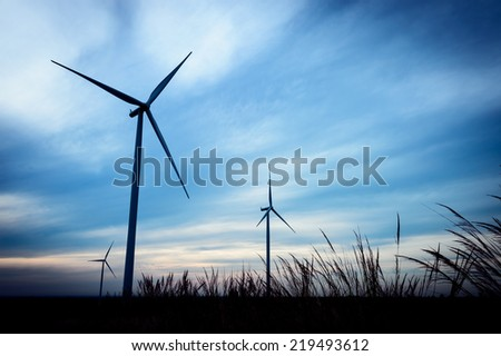 beautiful landscape image with Windturbine farm at the sunrise