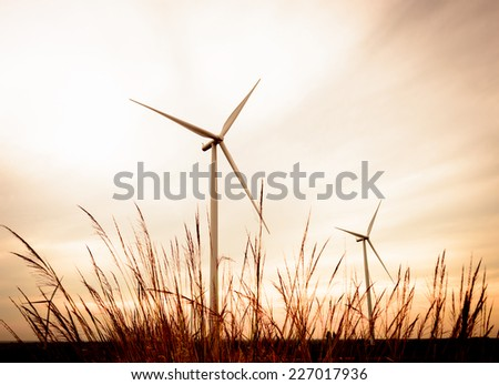 beautiful landscape image with Windturbine farm at the sunset - stock photo