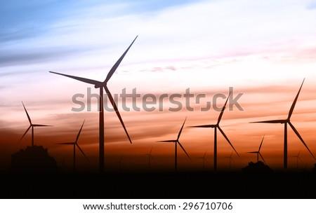 beautiful landscape image with Windturbine farm at the sunset - stock photo