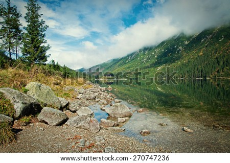 beautiful landscape in the mountains with lake - stock photo