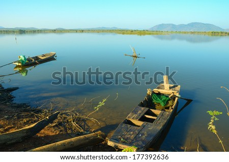 beautiful landscape in Vietnam. two wooden boats on the peaceful lake - stock photo