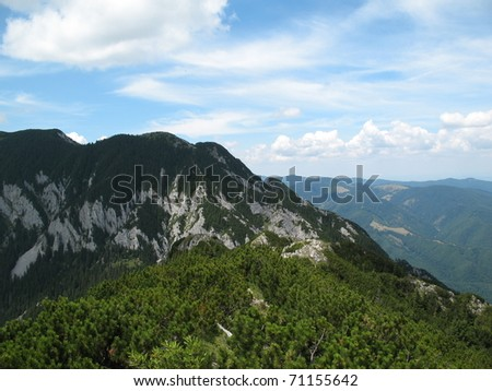 Beautiful landscape mountains covered with forests and cloudy skies