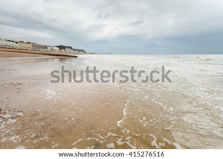 Beautiful landscape of Hastings in England. Spring seascape with rocky beach.