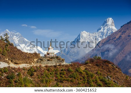 Beautiful landscape of Himalayas mountains with Tenzing Buddhist stupa and Ama Dablam mountain amazing view. Everest Base Camp trek - stock photo