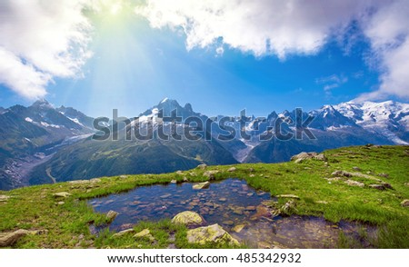 Beautiful landscape of lake with stones in the mountains Mont Blanc, the Alps, France (harmony, relaxation, meditation, background - concept)