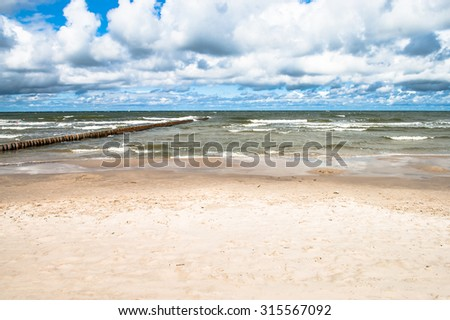 Beautiful landscape of sea beach, cloudy sky.  Baltic sea coast near Leba in Poland. - stock photo