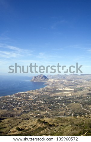 Beautiful landscape of Sicily, Italy for summer holidays - mountains, hills, meadows, blue sky and the sea. Panorama from Erice town in Agrigento province - stock photo
