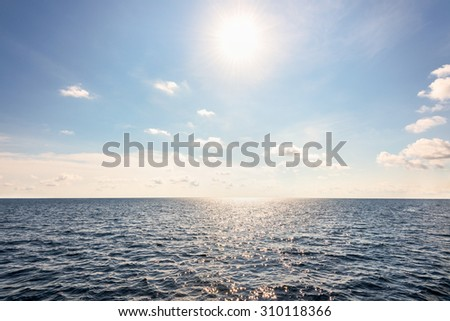 Beautiful landscape of sun on blue sky over the ocean middle Andaman Sea in summer at Mu Koh Similan National Park, Phang Nga Province, Thailand - stock photo