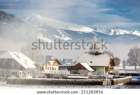 Beautiful landscape of traditional Austrian town in mountains covered by snow