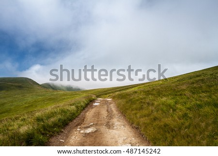 Beautiful landscape of Ukrainian Carpathian mountains and cloudy sky.