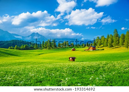 Beautiful landscape of valley in Alpine mountains, small houses in Seefeld, rural scene, majestic picturesque view - stock photo