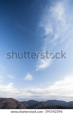 Beautiful landscape on mountains with nice sky with white fluffy clouds. Landscape diagonal composed photography.