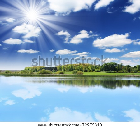 Beautiful landscape over a calm lake - stock photo