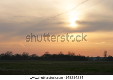 beautiful landscape sunset over the river in the forest in the spring - stock photo