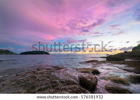 Beautiful landscape with colorful sunset on the sea.