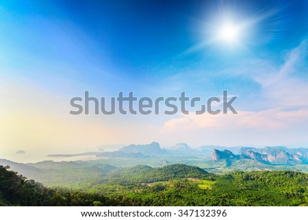 beautiful landscape with green mountains and colorful sky under sunshine in Thailand - stock photo