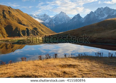 Beautiful landscape with lake in autumnal mountains. Greater Caucasus range.