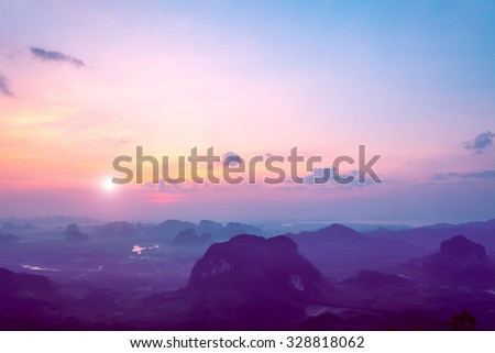 beautiful landscape with mountains and rocks under colorful sky in sunset in Thailand - stock photo