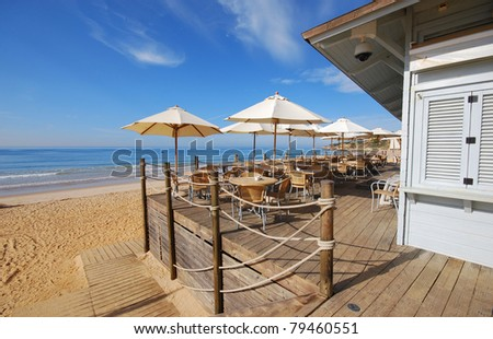 beautiful landscape with outdoor terrace on sand beach of Atlantic ocean(Algarve,Portugal) - stock photo