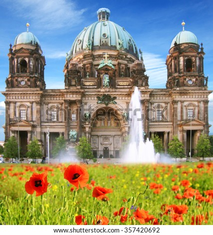 Beautiful landscape with poppies and Berlin Cathedral (Berliner Dom) in the historic center of Berlin, Germany - stock photo