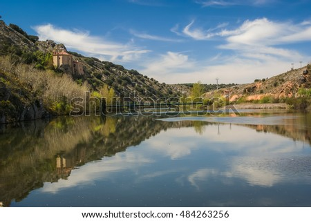 Beautiful landscape with river Duero, St. Saturio chirch and reflections in water in Soria, Castilla y Leon, Spain