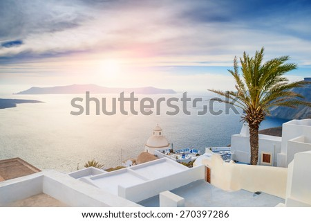 Beautiful landscape with sea view at sunset. White architecture on Santorini island, Greece.  - stock photo