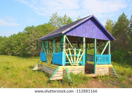 Beautiful landscape with summerhouse near green forest