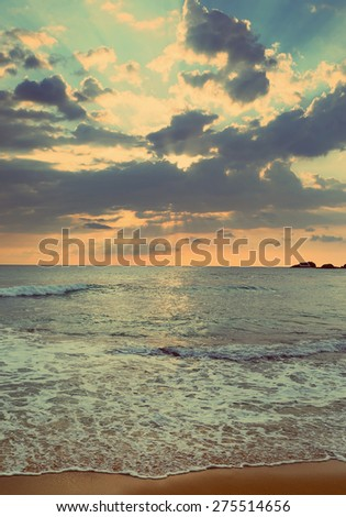 beautiful landscape with tropical sea sunset on the beach - vintage retro style - stock photo
