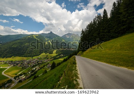 Beautiful landscape with village and road in the austrian alps. - stock photo