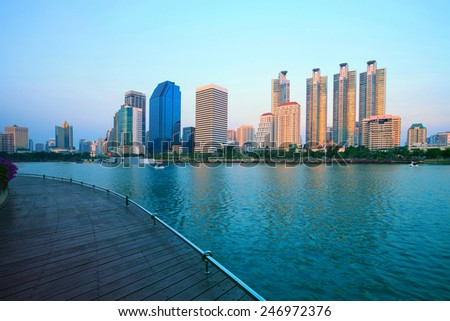 beautiful lanscape of benjakiti public park important landmark in heart of bangkok thailand the most beautiful lake scene and building sky scrapper in capital of thailand - stock photo