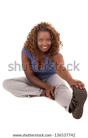 Beautiful large african woman doing exercise - Isolated over white