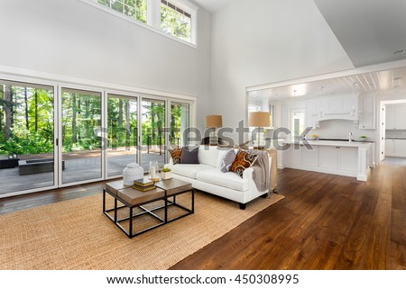 Beautiful Large Living Room With Hardwood Floors Couch And Sliding Glass Doors In New