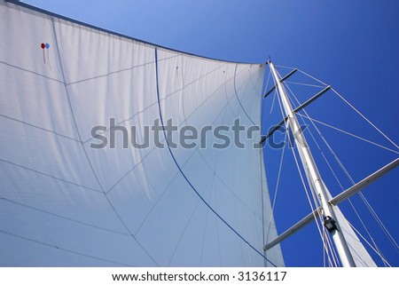 Beautiful large white sails on sailboat - stock photo