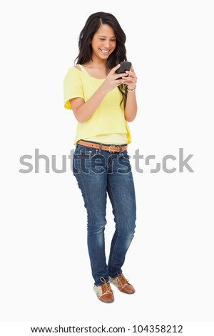 Beautiful Latin laughing while using a smartphone against white background - stock photo